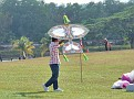 A Wau Kucin about to launch in the traditional kite competition.