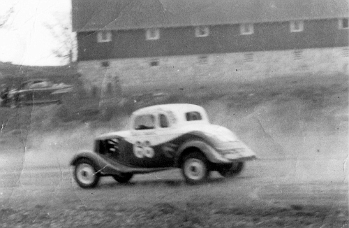 Slick Keeler coming off  4th turn at Jackson Highway 1951
