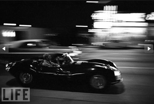 Steve McQueen in His Jaguar XKSS. Trailing Steve McQueen was Dominis' first