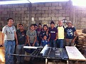Visiting Beekeepers in Guatemala.  Here is one of the workshops and workers.  Wooden ware behind us.