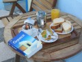 Breakfast on Fira, Santorini at a cool hotel...  15 Euro per night,,,  about 20 bucks...