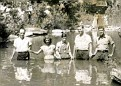 Old Time Baptising. If you know Where, please tell me so I can update this picture.  Left to right: Rev. James L. Lloyd, Pearl Lawson (or Tennessee Bowling), Tom Day, London Harness, and Rev. Roy Harness.