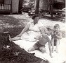"""Edna Marie (ANDERSON) Foust (1904-1970), wife of Parlon D. """"Frosty"""" Foust (1903-1947), who was killed in the coal mine accident at Dean, Scott County, TN.1st boy unknown. 2nd boy is her grandson, Ray Pergram."""